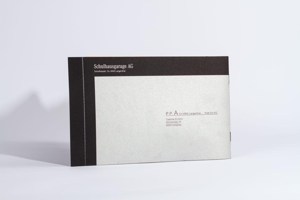 Tanner Druck AG, Versand Gutschein Schulhausgarage